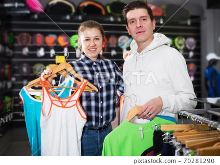 Couple demonstraiting new sportwear 70281290