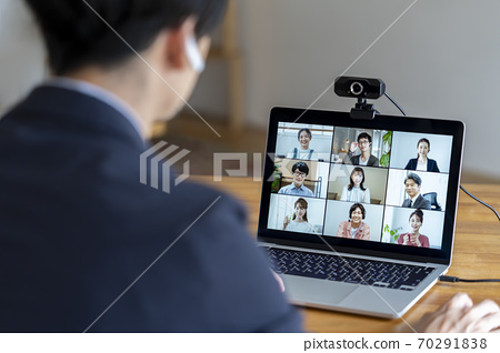 Image of the back of a man having an online meeting 70291838