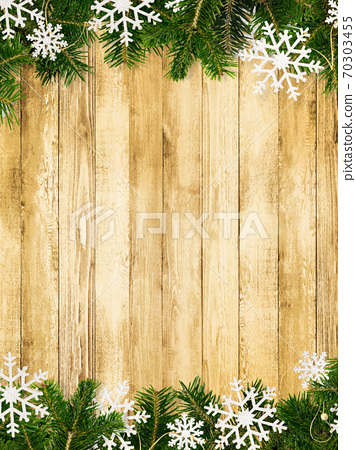 Wood grain background decorated with fir tree and snow ornaments-there are multiple variations 70303455