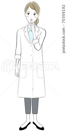 Worried woman in white coat 70309192