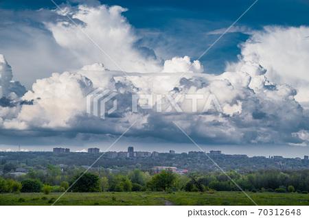 sky after rain with huge clouds. city skyline. 70312648