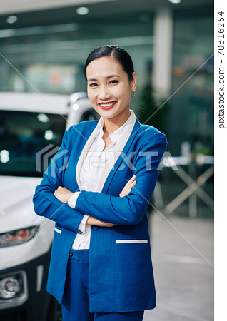 Confident car dealership manager 70316254