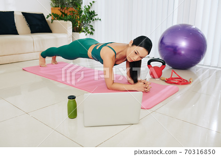 Woman in plank position 70316850