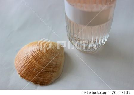 Perfume bottle and seashell 70317137