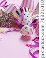 card with christmas decoration in pink background 70321010