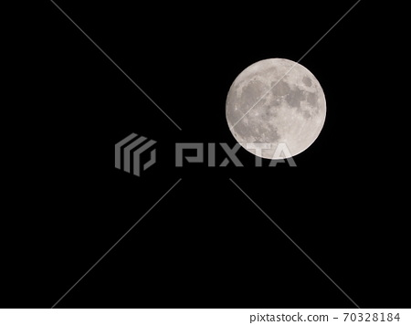 A beautiful moon that shines in the darkness of the night 70328184