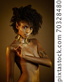 Colorful portrait of a beautiful afro girl wearing gold jewelry 70328480