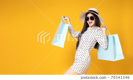 Asian pretty young woman  on yellow colour background. She smili 70341346