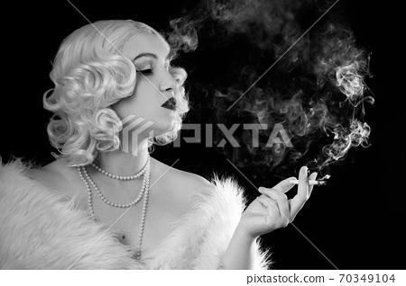 luxury woman smoking 70349104
