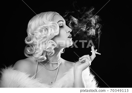 luxury woman smoking 70349113