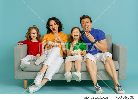Happy loving family on bright color background. 70366609