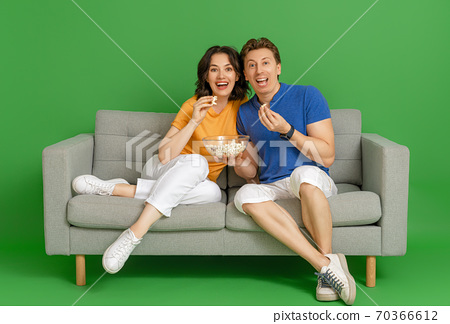 Happy couple on bright color background. 70366612