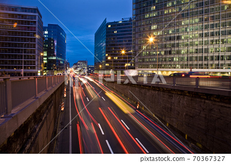 Traffic at night on the avenue in front of the Berlaymont 70367327