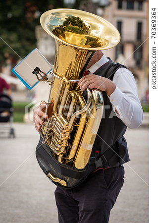 Musician of a Brass Band plays a Tuba - Padua Italy 70369364