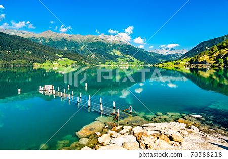Pier at Reschensee, an artificial lake in the Italian Alps 70388218