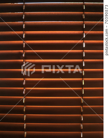 Closed golden jalousie texture with sunlight in the morning. Window with blinds interior design of living room decor. 70390873
