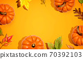 Autumn pumpkins with colorful leaves overhead view 70392103