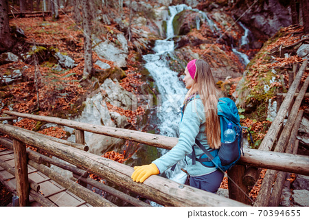 Hiking a gorge in the mountains during fall 70394655