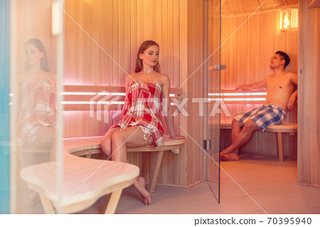 Woman and man in the sauna 70395940
