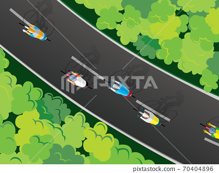 Aerial view of cyclists riding competition along a road between green meadows 70404896