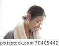Women with facial cleansing 70405442