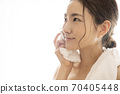 Women with facial cleansing 70405448
