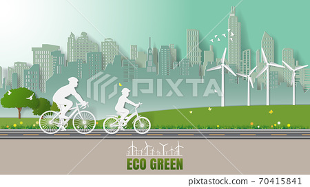 Green renewable energy environmentally friendly concepts, father and son are riding bicycle in city parks 70415841