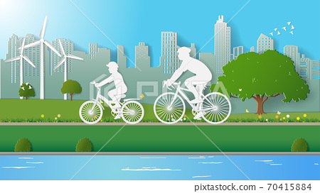 Green energy concepts, father and son are riding bicycle in city parks 70415884