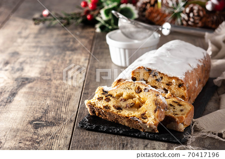 Christmas stollen fruit cake on wooden table.Copy space 70417196