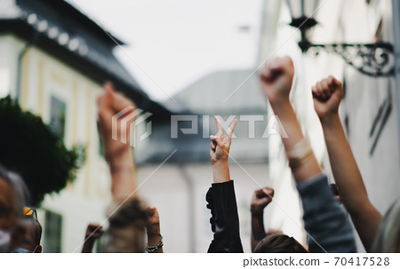 Arms and fists raised in the air, protest and demonstration concept. 70417528