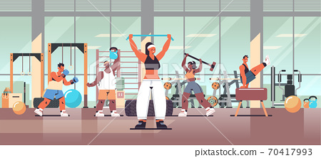 mix race people doing physical exercises working out fitness training healthy lifestyle concept 70417993