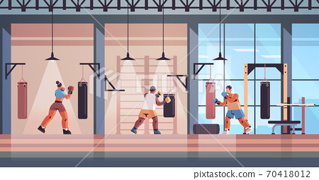 mix race boxers doing exercises with punching bag training healthy lifestyle boxing concept 70418012