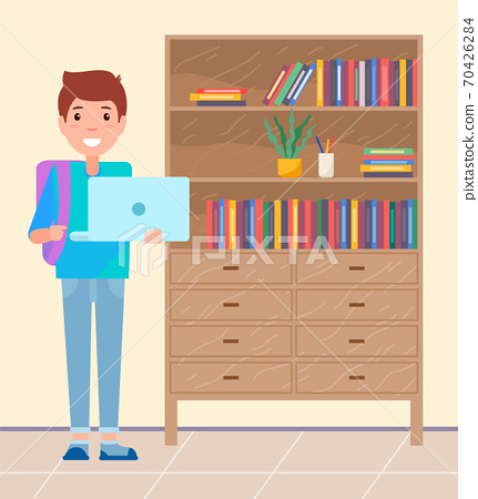 Student with laptop and backpack smiling, pupil standing near cabinet with books and decoration 70426284