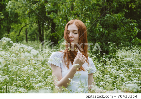 World mental health day, work-life balance, spread positive messages concept. Redhead woman in business suit enjoying nature 70433354