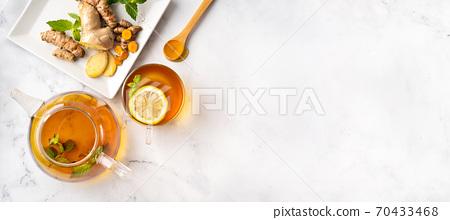 Aromatic turmeric tea with ginger and lemon 70433468