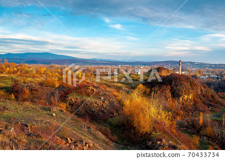 rural valley at sunset. beautiful autumn landscape in mountains. village in the distant valley. clouds on the blue evening sky 70433734