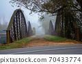 abandoned metal bridge in morning fog. dangerous construction in autumnal countryside scenery at sunrise 70433774