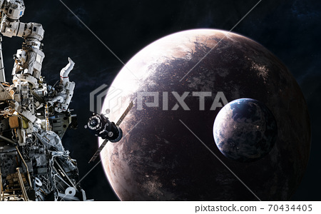 Space stations on background of inhabited planets in deep space 70434405