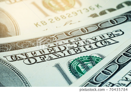 Close-up of large dollar bills. American currency. 70435784