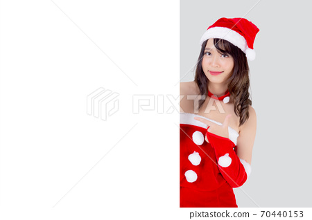 Beautiful young asian Santa woman holding blank board for xmas isolated. 70440153