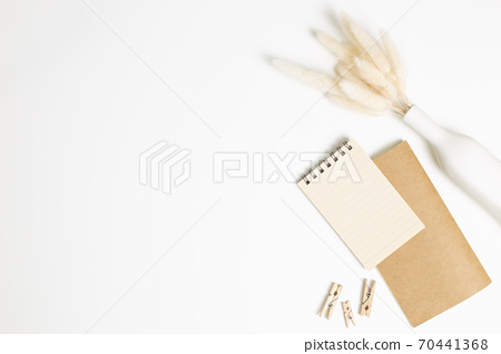Notebook with vase of dry grass on white background. flat lay, top view, copy space. Work and study place 70441368
