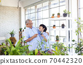 Asian grandfather and his grandson spent time together in the garden. 70442320