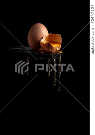 Concept image of a broken brown egg shell 70447207