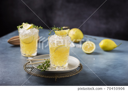 Cocktail with lemon, timo and crushed ice 70450906
