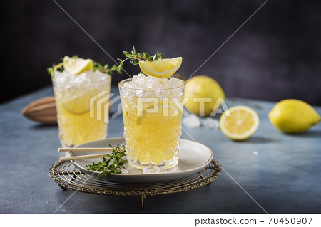 Cocktail with lemon, timo and crushed ice 70450907