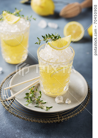 Cocktail with lemon, timo and crushed ice 70450908
