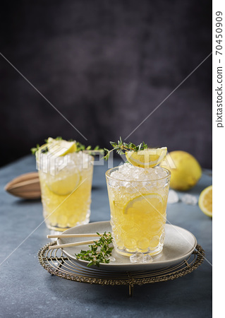 Cocktail with lemon, timo and crushed ice 70450909