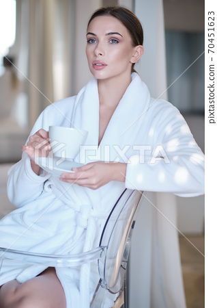 woman drinking morning coffee in her apartment 70451623