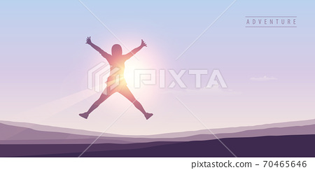 happy girl with raised arms jumps at sunshine 70465646