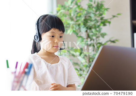 A girl learning online. 70479190